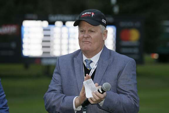 FILE - In this Oct. 16, 2016, file photo, Johnny Miller stands on the 18th green of the Silverado Resort North Course during the trophy presentation of the Safeway Open PGA golf tournament, in Napa, Calif. Television viewers haven't heard the last of Johnny Miller just yet. Miller says he thought this might be his final year in the broadcast booth for NBC Sports so he could spend more time with his 23 grandchildren. But in a telephone interview Monday, July 10, 2017, he said he will stick around for at least another year. This is his 28th year working for NBC.(AP Photo/Eric Risberg, File)