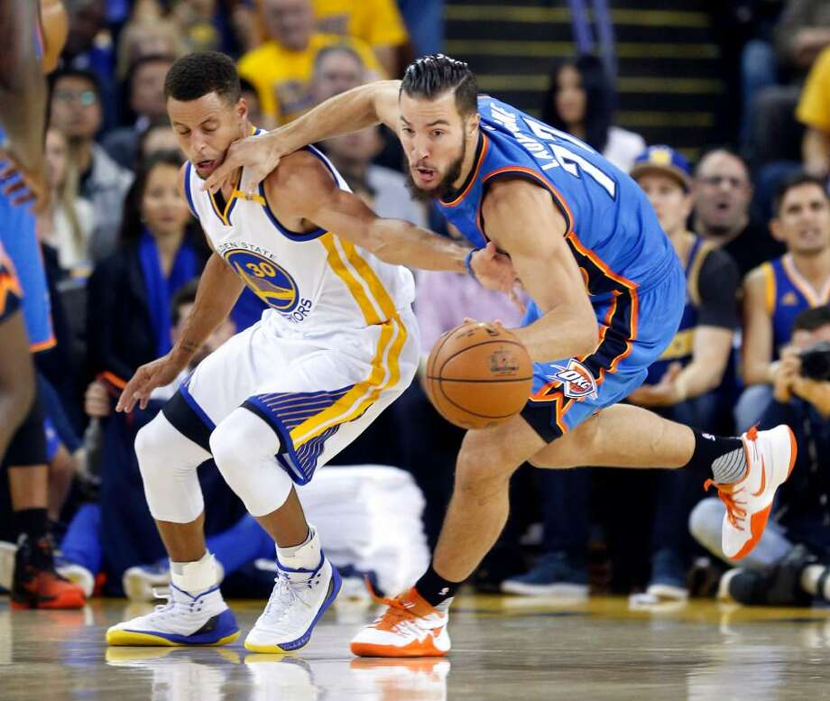 Golden State's Stephen Curry defends against Oklahoma City's Joffrey Lauvergne during a Nov. 3, 2016 game at Oracle Arena in Oakland, Calif. Photo: Associated Press /