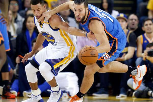 Golden State's Stephen Curry defends against Oklahoma City's Joffrey Lauvergne during a Nov. 3, 2016 game at Oracle Arena in Oakland, Calif.