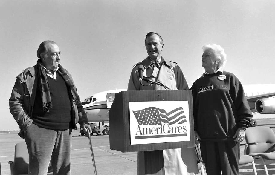 In this 1993 photo, Former President and First Lade George H.W. and Barbara Bush pay a visit to Americares. Phil Farnsworth/AmericaresKeep clicking for a peek at more old photos of the Houston power couple.