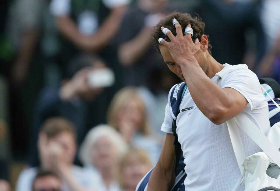 Spain's Rafael Nadal leaves the court after losing to Luxembourg's Gilles Muller in their Men's Singles Match on day seven at the Wimbledon Tennis Championships in London Monday, July 10, 2017. (AP Photo/Tim Ireland) Photo: Tim Ireland, STR / Copyright 2017 The Associated Press. All rights reserved.