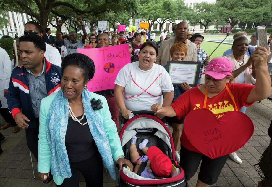 Congresswoman Sheila Jackson Lee, left, leads a march  outside City Hall, opposing the proposed Senate Healthcare Bill Monday, July 10, 2017, in Houston. Photo: Godofredo A. Vasquez, Houston Chronicle / Godofredo A. Vasquez