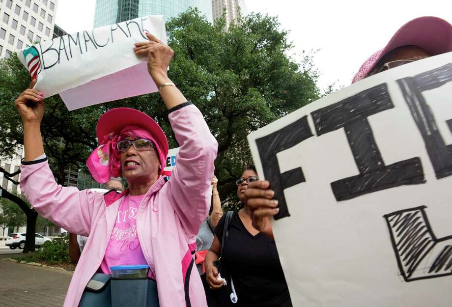 """Cynthia Adams, left, holds up a """"Save Obamacare"""" sign during a march to protest the proposed Senate Healthcare Bill, outside City Hall Monday, July 10, 2017, in Houston. Photo: Godofredo A. Vasquez, Houston Chronicle / Godofredo A. Vasquez"""