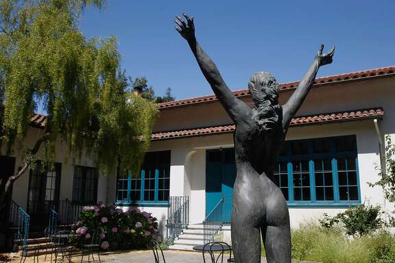 "A sculpture by Roberta Weir, 1986, ""Power of Woman"" is dedicated to the strong, proud women of Mills, at Mills College in Oakland, Ca. It is a gift from the classes of 1990 and 1991, and seen on Monday July 10, 2017. Mills College a private women's college founded in 1852 is having financial troubles and threatening to lay off 11 tenured professors and eliminate programs."
