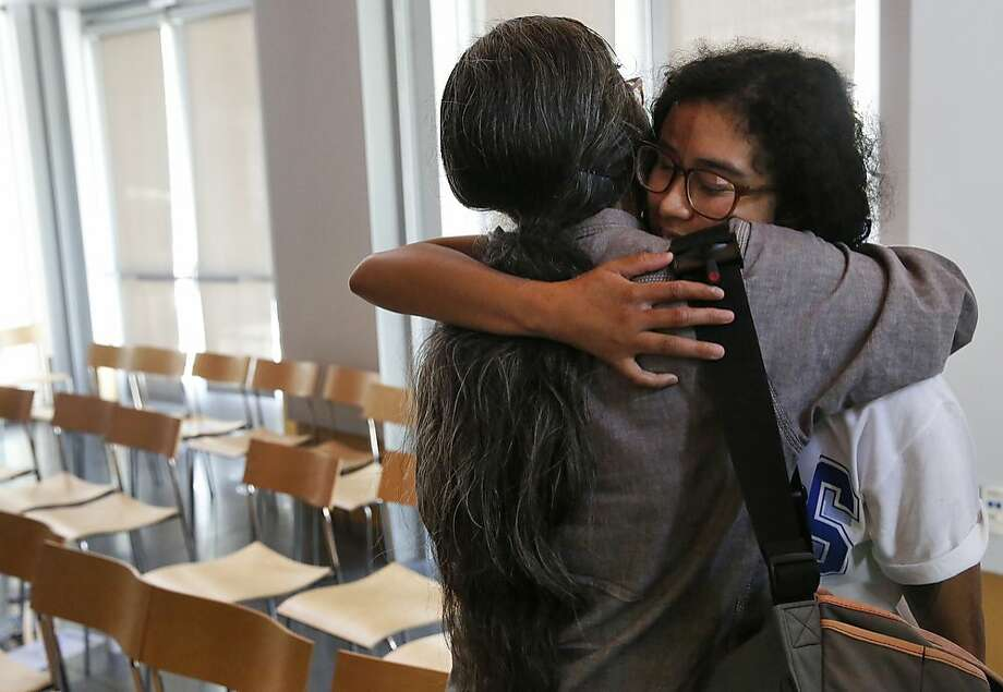 Professor Vivian Chin, left, hugs a student who testified in favor of keeping professor Chin at the college after a board of trustees meeting. Photo: Leah Millis, The Chronicle