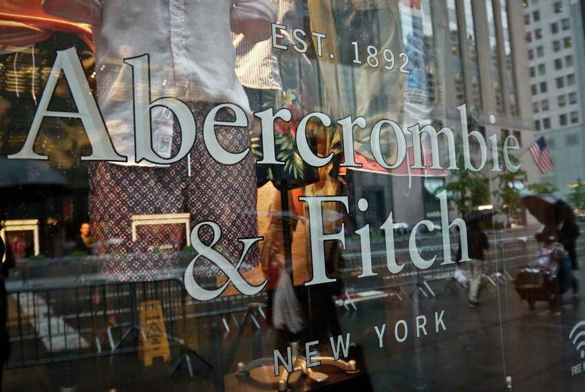 FILE - In this Monday, May 22, 2017, file photo, a store window reflects a street scene at an Abercrombie & Fitch store on New York's Fifth Avenue. On Monday, July 10, 2017, teen retailer Abercrombie & Fitch is no longer looking to sell itself, announcing that it will stick with its current strategy. (AP Photo/Bebeto Matthews, File) ORG XMIT: NYBM121