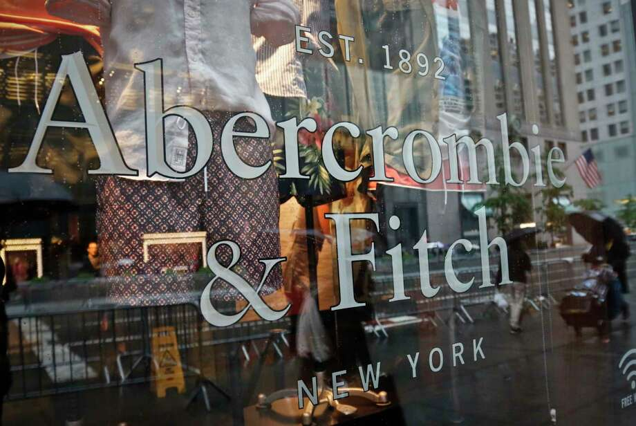 FILE - In this Monday, May 22, 2017, file photo, a store window reflects a street scene at an Abercrombie & Fitch store on New York's Fifth Avenue. (AP Photo/Bebeto Matthews, File) ORG XMIT: NYBM121 Photo: Bebeto Matthews / Copyright 2017 The Associated Press. All rights reserved.