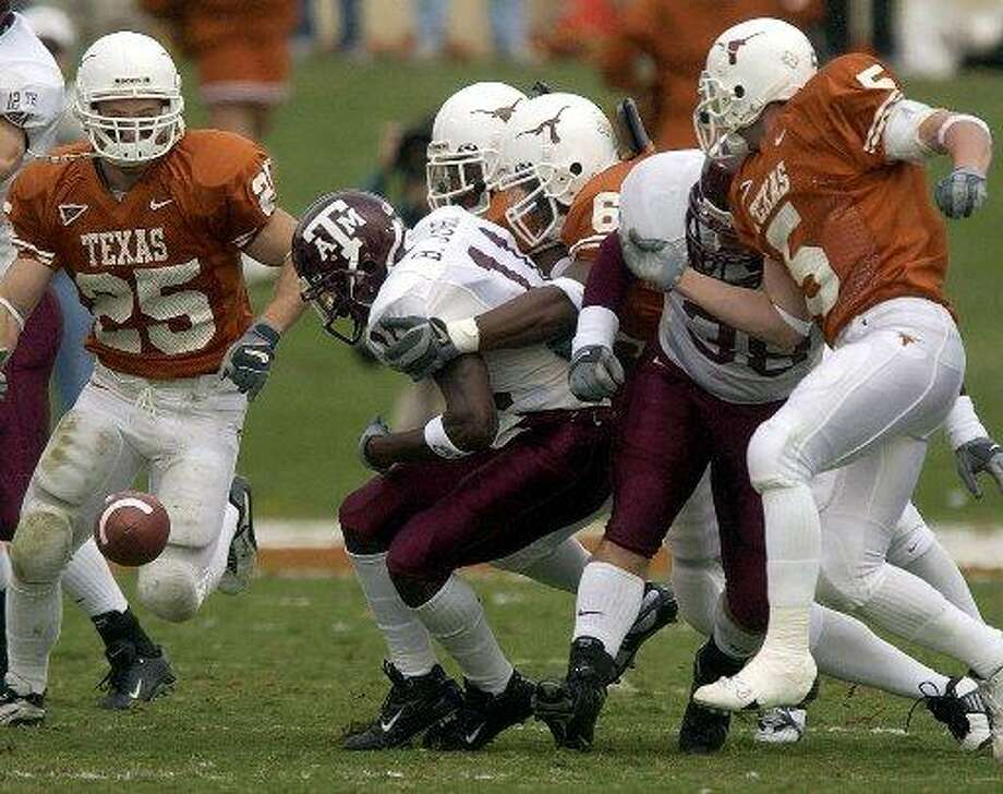Back when the Texas Longhorns and Texas A&M Aggies used to play each other in football every year, this is what the game looked like. Aggies kick-off returner Byron Jones fumbles the ball Nov 29, 2002 at Darrrell K. Royal-Texas Memorial Stadium in Austin. Photo: William Luther /Express-News