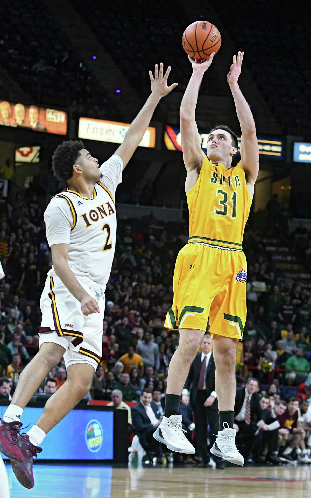 Siena's Brett Bisping is guarded by Iona's E.J. Crawford as he takes a jump shot during the MAAC men's championship game at the Times Union Center on Monday, March. 6, 2017 in Albany, N.Y. (Lori Van Buren / Times Union)