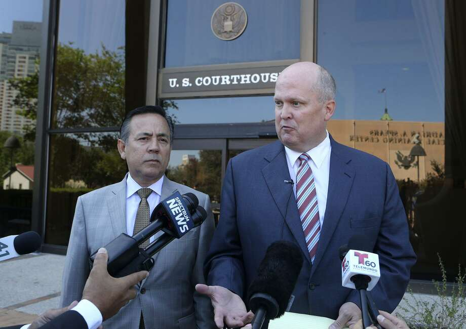 Attorney Mikal Watts (right) has been removed as counsel for state Sen. Carlos Uresti in a fraud case. A federal judge on Wednesday agreed with a prior ruling that Watts has a conflict of interest that outweighs Uresti's right to choose his own legal counsel. Photo: JOHN DAVENPORT /San Antonio Express-News / ©John Davenport/San Antonio Express-News
