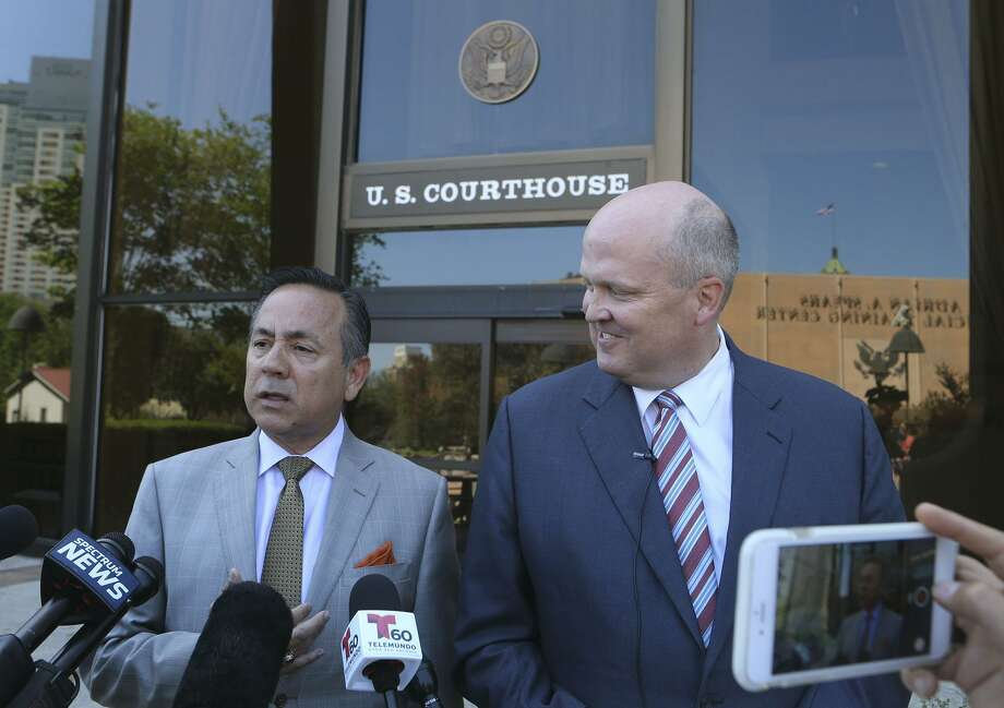 The Securities and Exchange Commission seeks to quash a subpoena it received from state Sen. Carlos Uresti (left), who is represented by attorney Mikal Watts (right). The SEC revealed in a court filing Friday that it has been conducting an investigation into FourWinds Logistics, a defunct oil field services company that Uresti provided legal services to in 2014. Uresti is facing criminal charges in connection with his involvement in FourWinds. Photo: John Davenpot /San Antonio Express-News / ©John Davenport/San Antonio Express-News