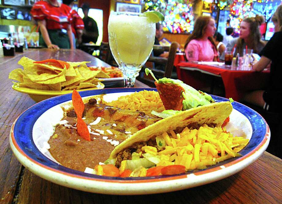 The George's Special plate includes a crispy beef taco, cheese enchilada, rice, beans and guacamole at Mi Tierra Cafe y Panadería. Photo: Mike Sutter /Staff File Photo
