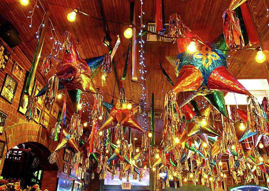 Piñatas line the ceiling above the bakery at Mi Tierra Cafe y Panadería at Market Square in San Antonio. Photo: Mike Sutter /San Antonio Express-News