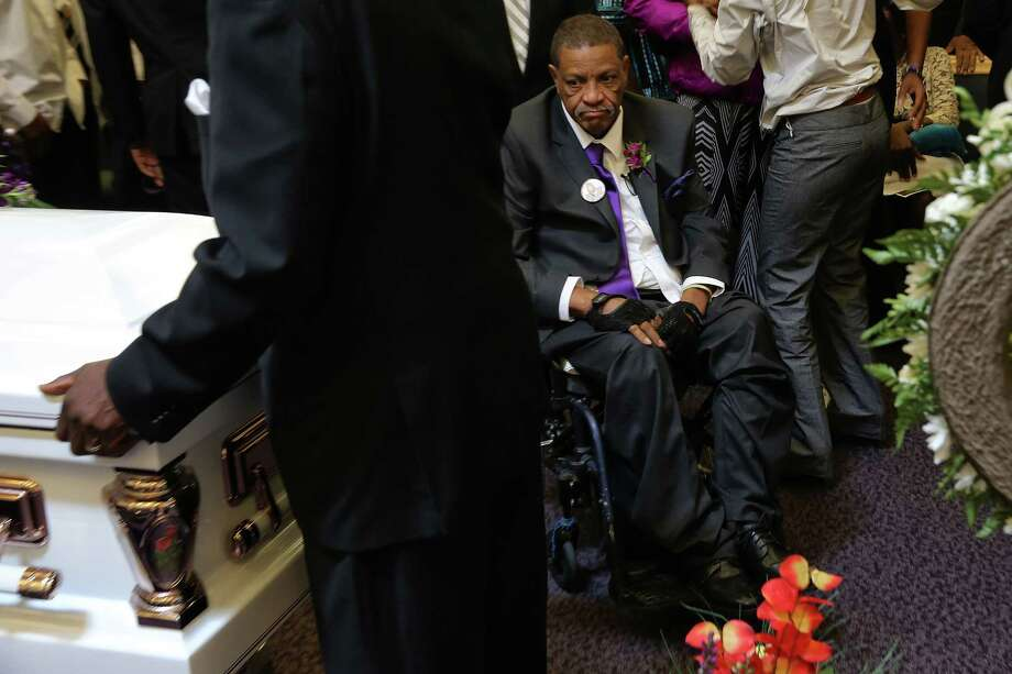 Charles Lyles Jr., father of Charleena Lyles, glances one last time at his daughter's casket after her funeral at New Hope Missionary Baptist Church, Monday, July 10, 2017. Charleena Lyles was killed by Seattle police officers after calling them for help, on June 18. Photo: GENNA MARTIN, SEATTLEPI.COM / SEATTLEPI.COM