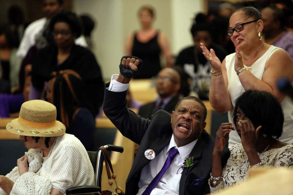 Charles Lyles Jr. raises a fist in the air and shouts his daughter's name during her funeral at New Hope Missionary Baptist Church, Monday, July 10, 2017. Charleena Lyles was killed by Seattle police officers at her home on June 18.