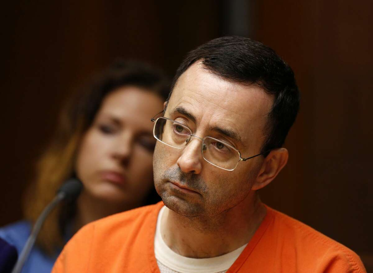 FILE - Former Michigan State University and USA Gymnastics doctor Larry Nassar is seen in the 55th District Court where Judge Donald Allen Jr. bound him over on June 23, 2017 in Mason, Michigan to stand trial on 12 counts of first-degree criminal sexual conduct.
