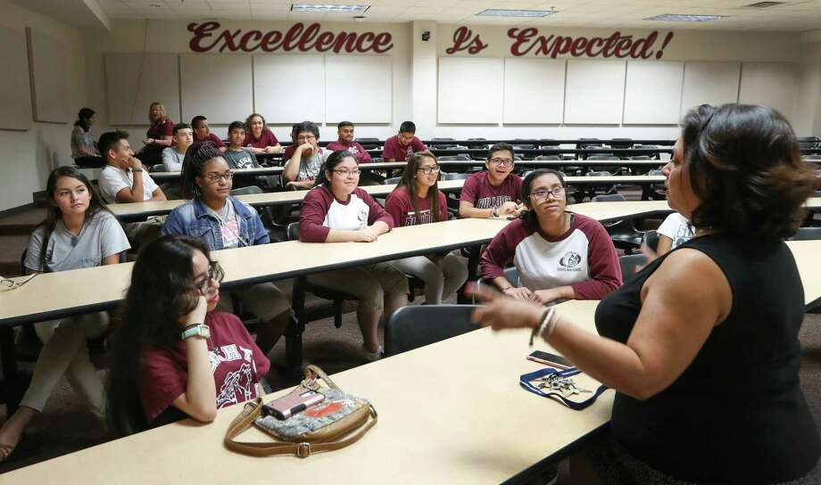Heights High School Campus Instructional Technologist Tisha Mesa talks to students Monday in Houston. The school and other campus' will benefit from the Raise Your Hand Texas Foundation launching Raising Texas Teachers program. Photo: Steve Gonzales, Staff / © 2017 Houston Chronicle