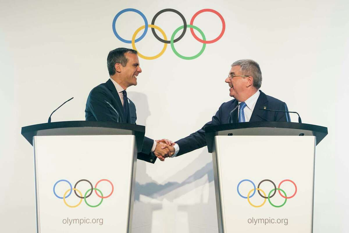 Eric Garcetti, left, Mayor of Los Angeles and International Olympic Committee, IOC, President Thomas Bach from Germany, right, shake hands during a visit of the Los Angeles 2024 Candidate City delegation, at the Olympic Museum, in Lausanne, Switzerland, Monday, July 10, 2017. (Jean-Christophe Bott/Keystone via AP) ORG XMIT: XLAU115