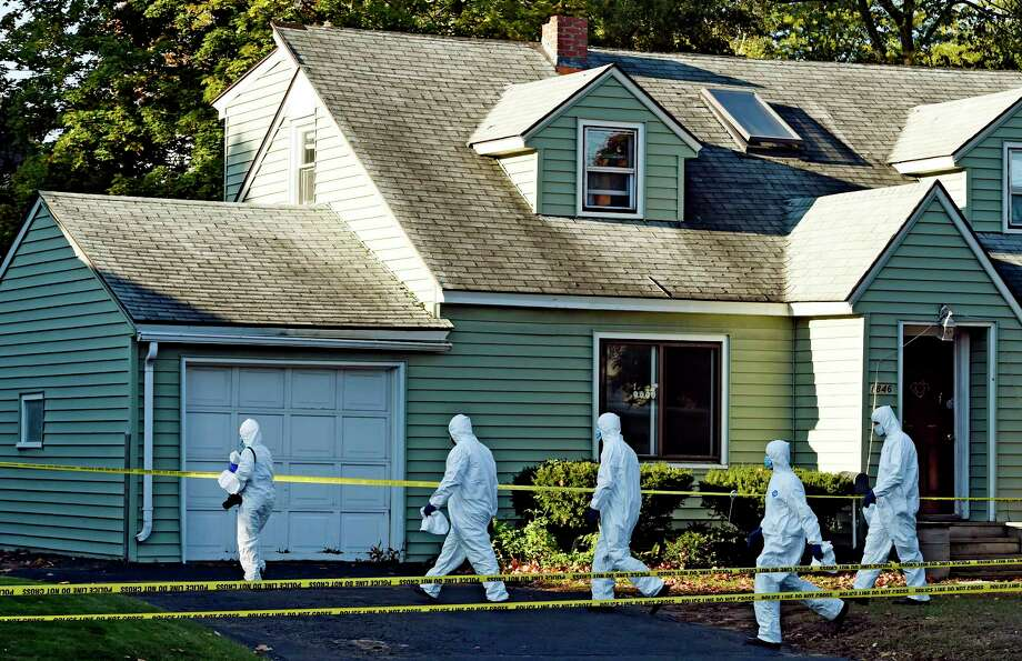 Members of the Albany County District Attorney's office prepare to enter the scene of a quadruple homicide at 1846 Western Avenue lead by acting Sr. Inv. Kelly Strack early Thursday morning Oct. 9, 2014 in Guilderland, N.Y.     (Skip Dickstein/Times Union) Photo: SKIP DICKSTEIN / 10028967A