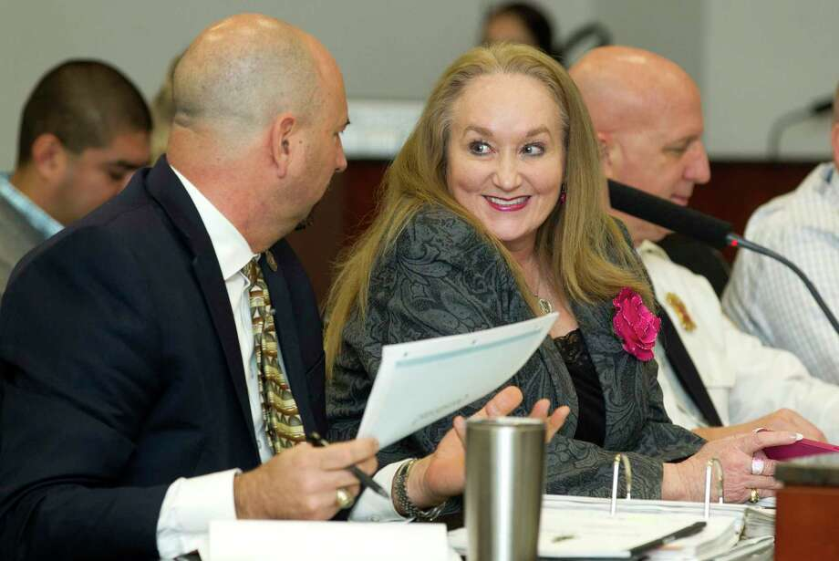 Conroe Director of Community Development Nancy Mikeska, center, shares a laugh with Assistant City Administrator Steve Williams during a city council meeting Wednesday, Jan. 26, 2017, in Conroe. Photo: Jason Fochtman, Staff Photographer / © 2017 Houston Chronicle