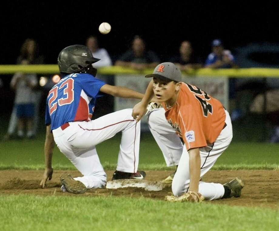 Stamford North's Antonio Belgrove gets back to second as the ball comes in to Ridgefield's Daniel Bucciero in the District 1 Little League semifinal game played at Springdale Little League Field in Stamford. Monday, July 10, 2017 Photo: Scott Mullin / For Hearst Connecticut Media / The News-Times Freelance