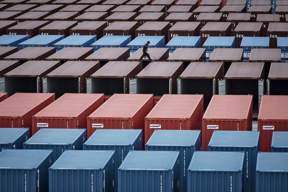 A worker inspects shipping containers in a stockyard at a factory in Qidong, China. Photo: Qilai Shen / © 2017 Bloomberg Finance LP