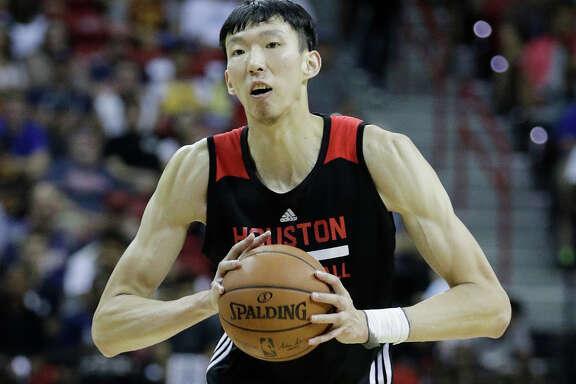 Houston Rockets' Zhou Qi plays against the Phoenix Suns during the NBA summer league basketball game, Monday, July 10, 2017, in Las Vegas. (AP Photo/John Locher)