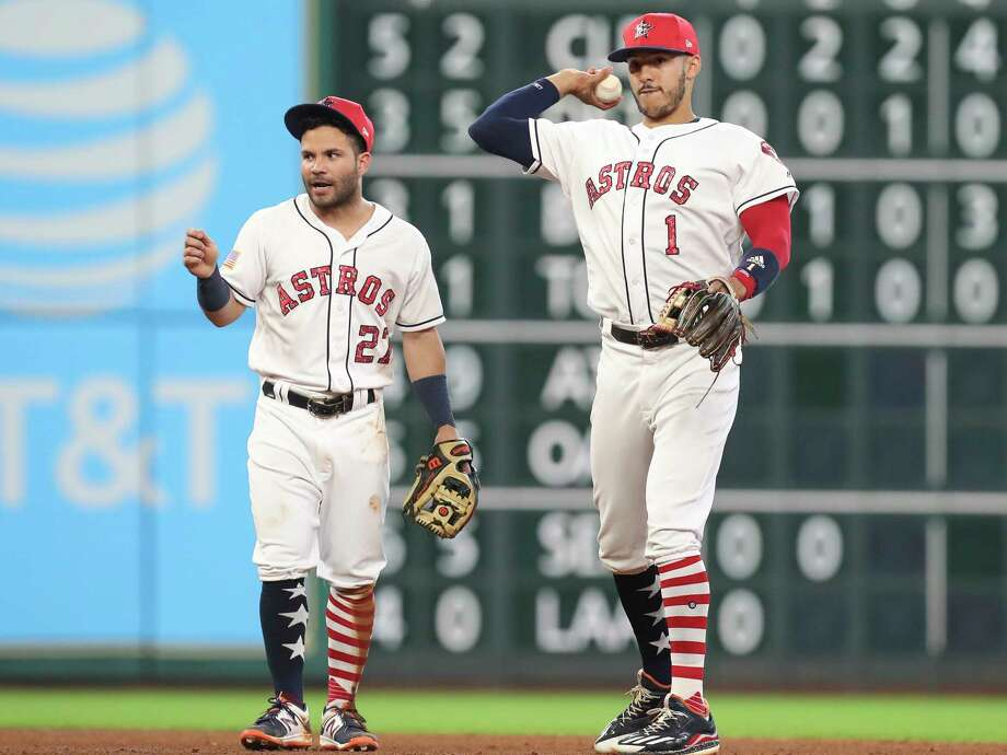 Houston Astros second baseman Jose Altuve (27) and Houston Astros shortstop Carlos Correa (1) during practice before the top fifth inning of the game at Minute Maid Park Sunday, July 2, 2017, in Houston. ( Yi-Chin Lee / Houston Chronicle ) Photo: Yi-Chin Lee, Staff / © 2017  Houston Chronicle