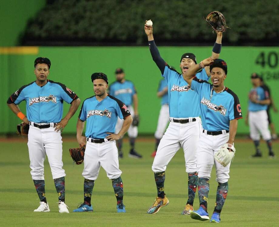 American League infielders, from left, Starlin Castro of the Yankees, Jose Altuve and Carlos Correa of the Astros, and Francisco Lindor of the Indians enjoy some All-Star fun on the field at Marlins Park prior to the start of Monday's night's Home Run Derby. Photo: Patrick Farrell, MBR / Miami Herald