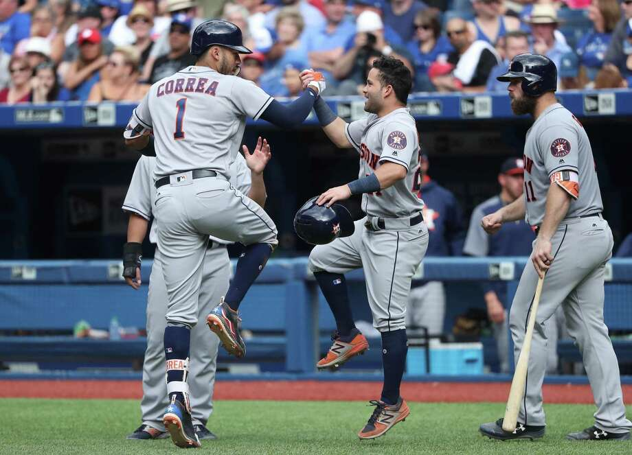 Carlos Correa, Jose Altuve, Evan Gattis and the Astros enter the All-Star break on top of the American League at 60-29. They lead the league in runs scored and are third in ERA. Photo: Tom Szczerbowski /Getty Images File / 2017 Getty Images