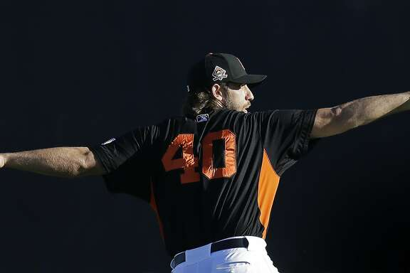 San Francisco Giants pitcher Madison Bumgarner warms up during a rehab assignment with the San Jose Giants as they host the Modesto Nuts in a baseball game Monday, July 10, 2017, in San Jose, Calif. Bumgarner has been on the disabled list since suffering a sprained AC joint in his pitching shoulder along with bruised ribs after a dirt bike accident earlier this season. (AP Photo/Ben Margot)