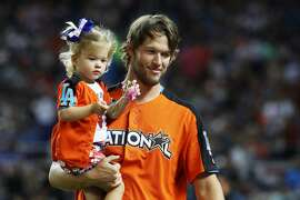 MIAMI, FL - JULY 10:  Clayton Kershaw #22 of the Los Angeles Dodgers and the National League holds his daughter Cali Ann during the T-Mobile Home Run Derby at Marlins Park on July 10, 2017 in Miami, Florida.  (Photo by Rob Carr/Getty Images)