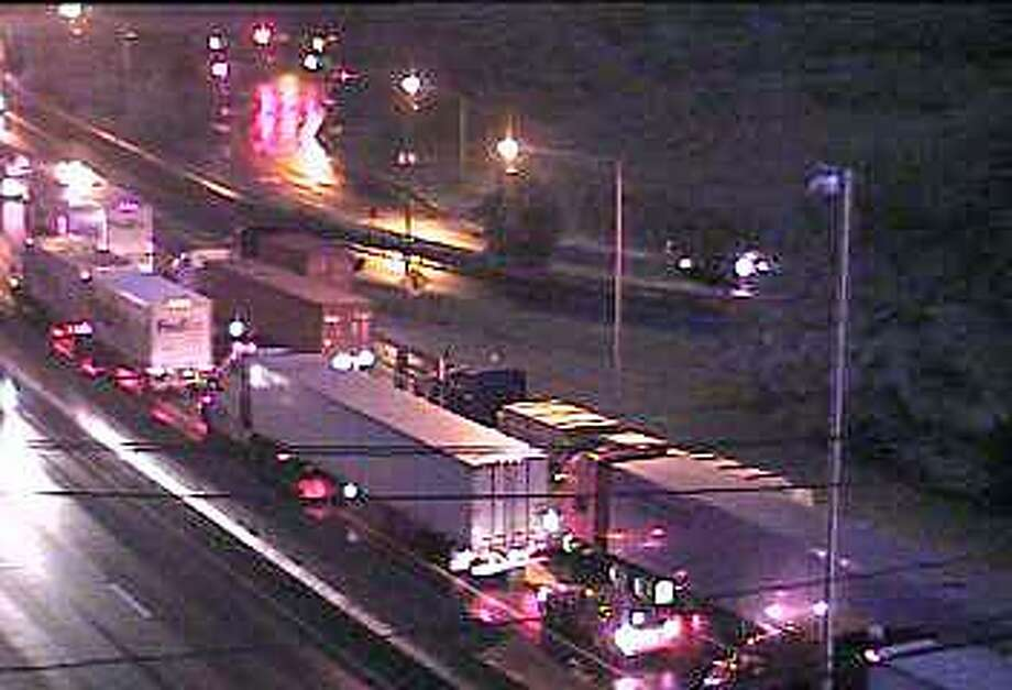 Northbound traffic crawls past a truck accident on I-95 in Norwalk on Tuesday, July 11, 2017. Two northbound lanes were closed following the accident reported around 4:45 a.m. Photo: Connecticut DOT