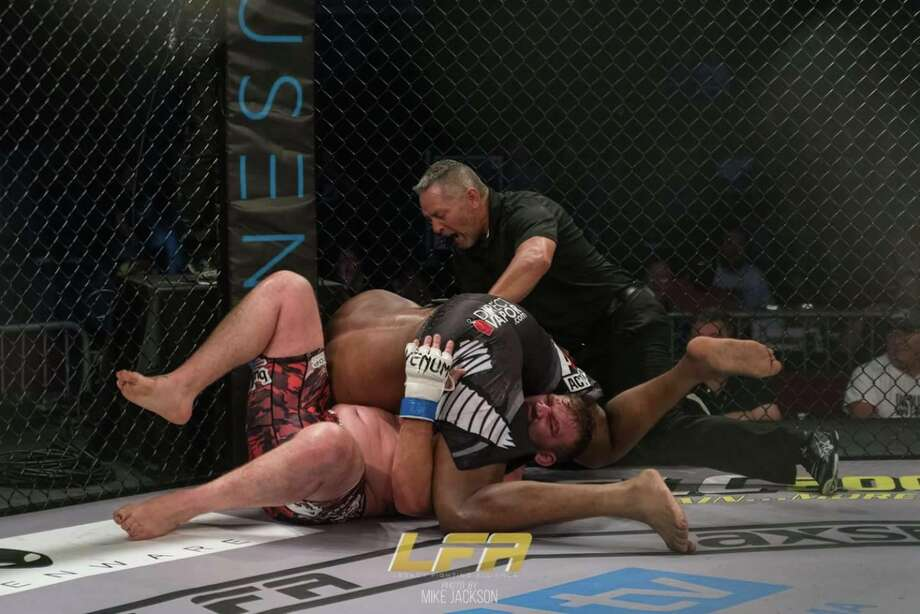 "Richard Odoms, a tactics instructor at the SAPD academy who moonlights as a mixed martial artist, was recently named the the heavyweight champion of the Legacy Fighting Alliance, a feeder league for the UFC. Photo: Mike ""The Truth"" Jackson"