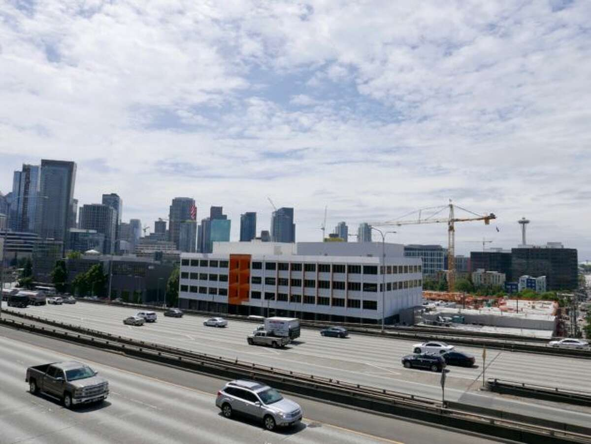 The former Pemco headquarters is one of the most visible buildings in Seattle, with thousands of cars driving by on Interstate 5 every day.
