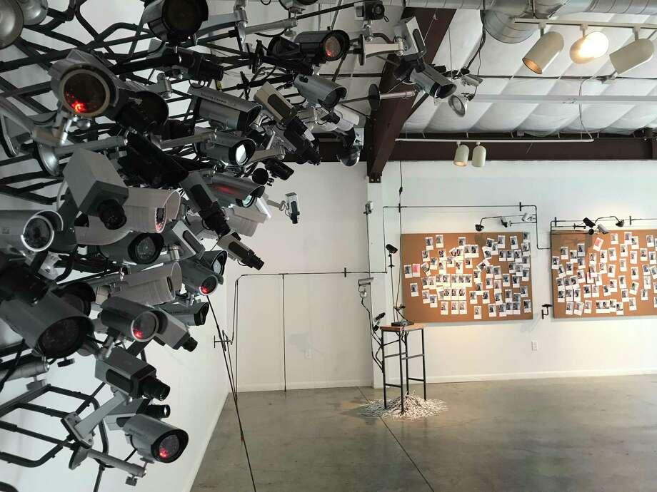 "Edward Kelley's ""Speak of the Devil"" contains working surveillance cameras. Photo: Molly Glentzer, Houston Chronicle"
