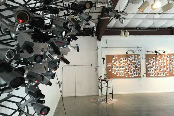 """A view of Edward Kelley's interactive installation """"Speak of the Devil,"""" which contains working surveillance cameras, at Art League Houston through July 22."""