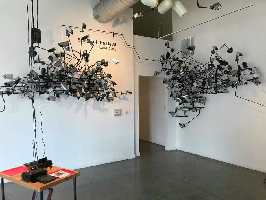 About a third of the 250 CCTV cameras Edward Kelley has installed in the  front gallery of Art League Houston are motion-activated. Photo: Molly Glentzer, Houston Chronicle