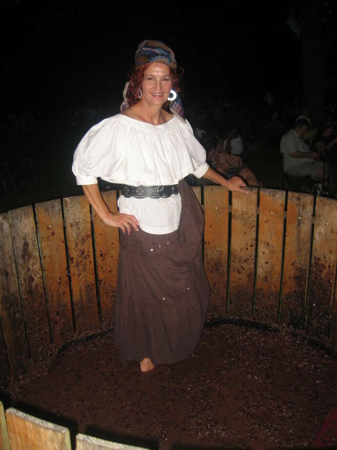 "Jerri Bernhardt crushing grapes in her ""Lucy Garb"" at Bernhardt winery's grape stomp pit."