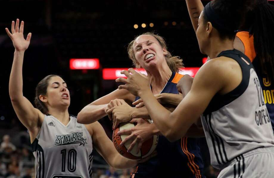 Connecticut Sun forward Kayla Pedersen, center, is pressured by San Antonio Stars guard Kelsey Plum (10) and San Antonio Stars forward Nia Coffey (12) during the first half of a WNBA basketball game, Wednesday, July 5, 2017, in San Antonio. Photo: Eric Gay /AP Photo