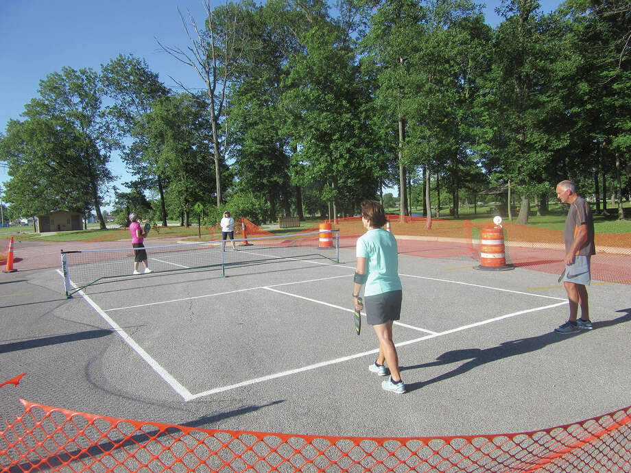 Maryville Parks and Rec will continue to introduce Pickleball with 2-hour sessions on the west side of Drost Park.   Members of the committee will be teaching anyone 18 years or older the rules and how to play the game.  The sessions will start Tuesday July 11 and continue each Tuesday during the months of July and August from 8:00-10:00AM.  Paddles and balls will be provided.  Wear comfortable clothing and tennis shoes.  The court is being set up at the end of E. Division St. past the Community Center, near Pavilion #7. Google 500 W. Division St., Maryville or contact Bob at 830-0640 or Sharon at 772-8555 for more information. Photo: For The Intelligencer