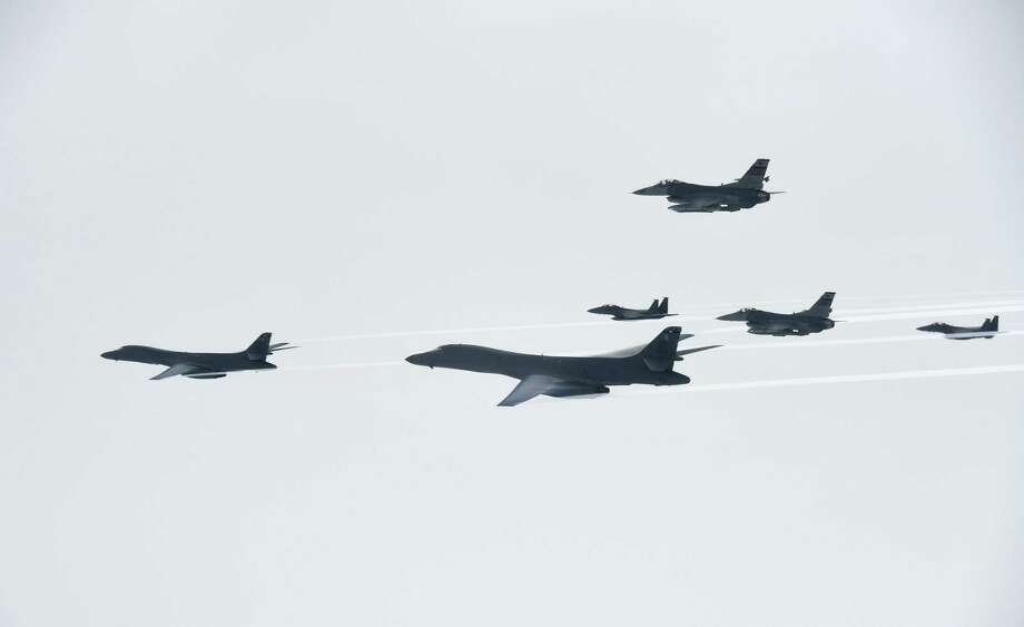 In this photo provided by South Korea Defense Ministry, U.S. Air Force B-1B Lancer bombers, left and second from left, fly with South Korean and U.S. fighter jets over the Korean Peninsula, South Korea Saturday, July 8, 2017. Two U.S. bombers flew to the Korean Peninsula to join fighter jets from South Korea and Japan for a practice bombing run as part of a training mission in response to North Korea's ballistic missile and nuclear programs, officials said Friday. (South Korea Defense Ministry via AP) Photo: Associated Press / South Korea Defense Ministry