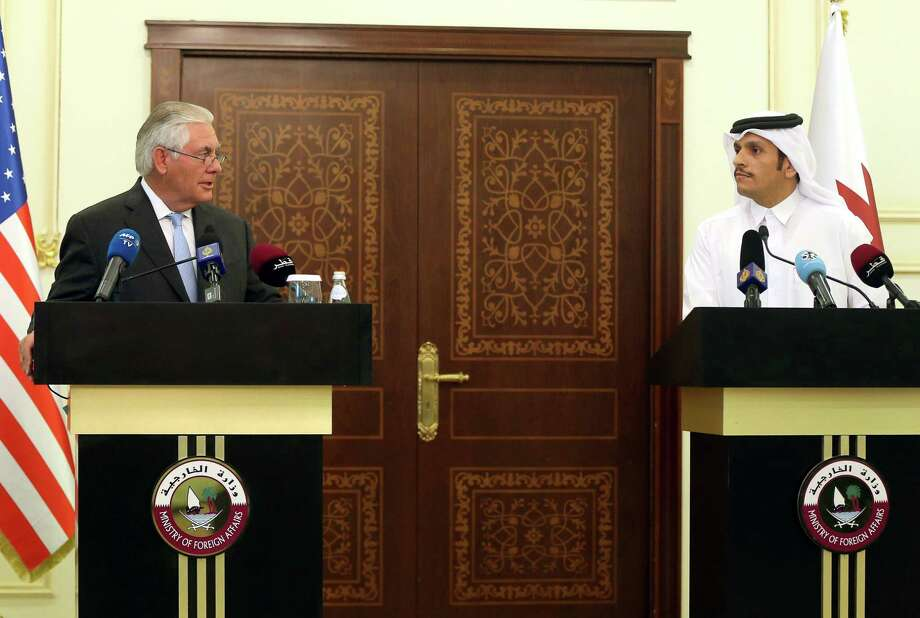 US Secretary of State Rex Tillerson and Qatari Foreign Minister Sheikh Mohammed bin Abdulrahman Al-Thani speak during a press conference in Doha, on July 11, 2017. The US and Qatar announced they have signed an agreement on fighting terrorism, at a time when the emirate is facing sanctions from neighbouring countries which accuse it of supporting extremism. / AFP PHOTO / STRINGERSTRINGER/AFP/Getty Images Photo: STRINGER, Contributor / AFP/Getty Images / AFP or licensors