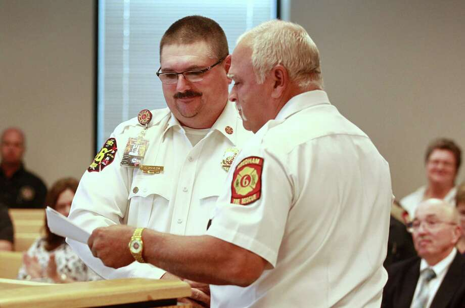 Needham Fire Department Chief Kevin Hosler, left, receives a proclamation for his work with the community during Commissioners Court at the Alan B. Sadler Commissioners Court Building, Tuesday, July 11, 2017, in Conroe. Photo: Jason Fochtman, Staff Photographer / Conroe Courier / HCN