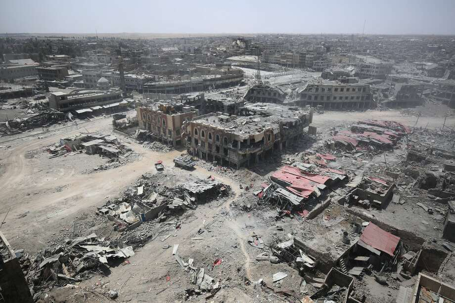 A picture taken on July 9, 2017, shows a general view of the destruction in Mosul's Old City. Iraq will announce imminently a final victory in the nearly nine-month offensive to retake Mosul from jihadists, a US general said Saturday, as celebrations broke out among police forces in the city. Photo: AHMAD AL-RUBAYE/AFP/Getty Images