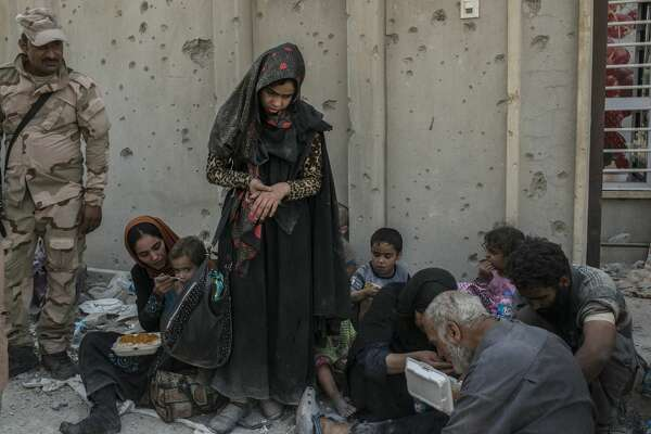 MOSUL, IRAQ - JULY 10: Iraqi civilians in the Islamic State occupied Old City district on July 10, 2017 in Mosul, Iraq. The Iraqi government and armed forces have declared victory but fighting continues. (Photo by Martyn Aim/Corbis via Getty Images)