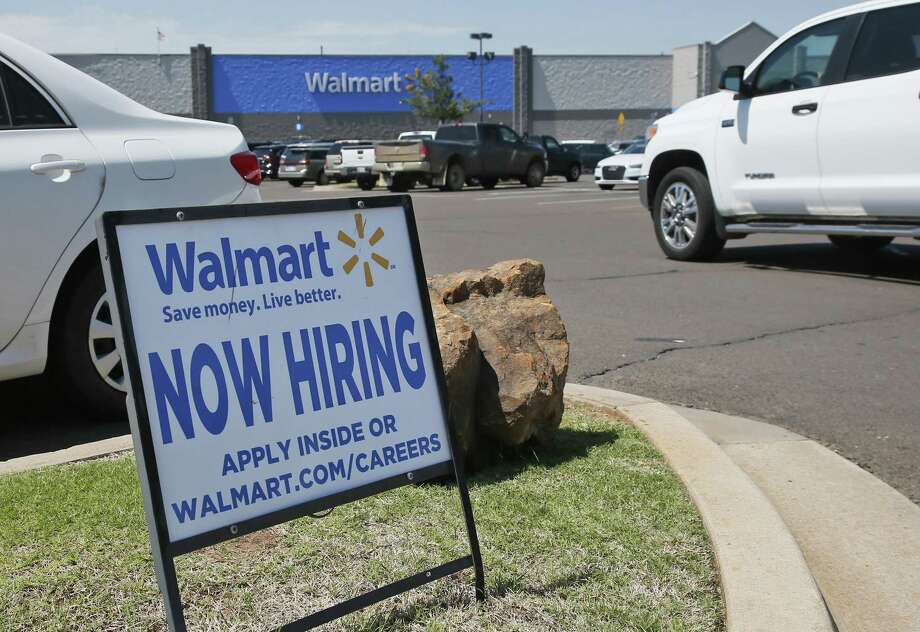 This Walmart store announces that it's hiring in Oklahoma City. Job openings fell 5 percent in May to 5.7 million, the Labor Department said Tuesday. The setback occurred after advertised job postings nearly reached 6 million in April, a figure that has been revised downward from the initial report. Photo: Sue Ogrocki /Associated Press / AP2017