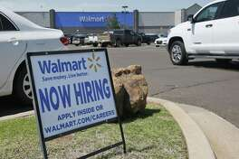This Walmart store announces that it's hiring in Oklahoma City. Job openings fell 5 percent in May to 5.7 million, the Labor Department said Tuesday. The setback occurred after advertised job postings nearly reached 6 million in April, a figure that has been revised downward from the initial report.