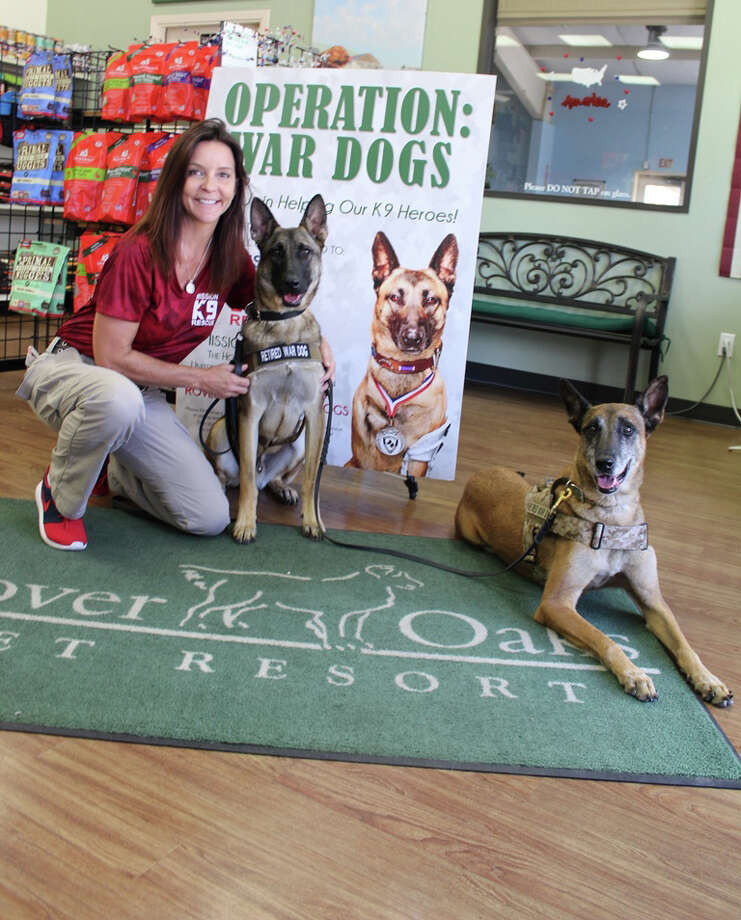 Kristen Maurer, founder and president of Mission K9 Rescue with retired war dogs Gina and Kilo visting Rover Oaks Pet Resort. Photo: Rover Oaks Pet Resort