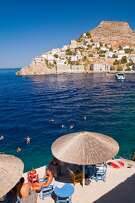 Swimming in the harbour at Hydra Town, Hydra.